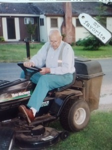old man riding lawn mower