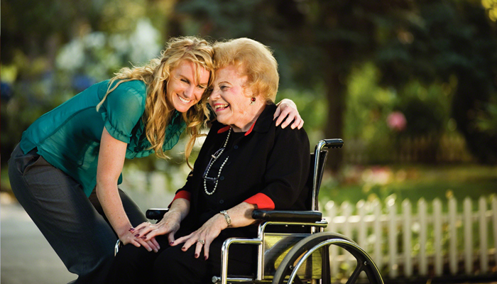 girl with lady in wheelchair