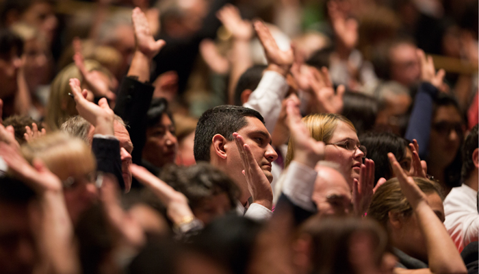 Mormon congregation raising hands