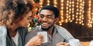 man and woman drinking hot chocolate at home
