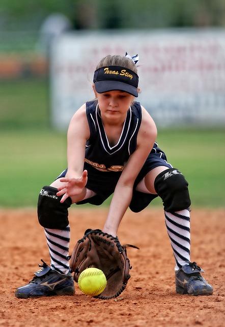 girl fielding softball