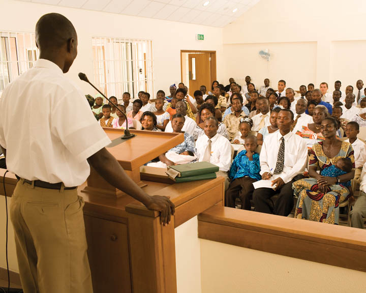 man addressing audience from pulpit