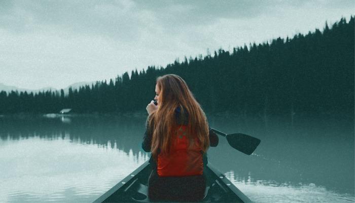 girl rowing on lake