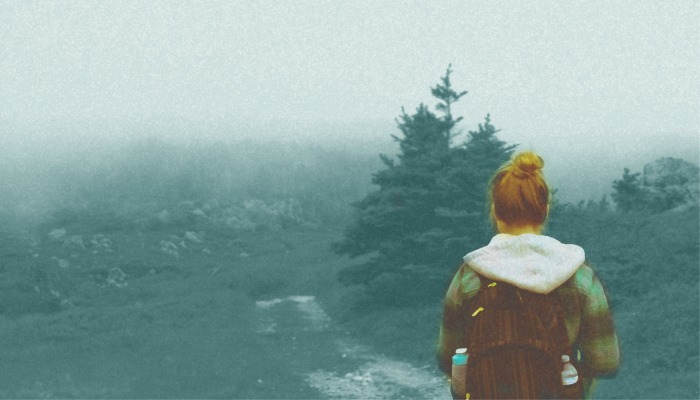 girl hiking in fog