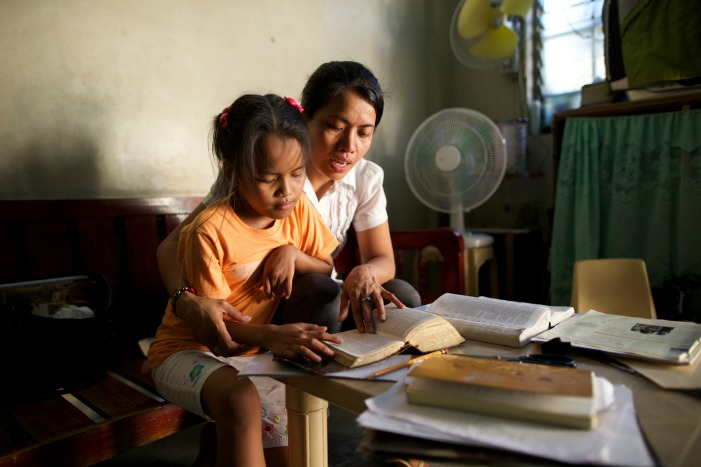 mother and child study together