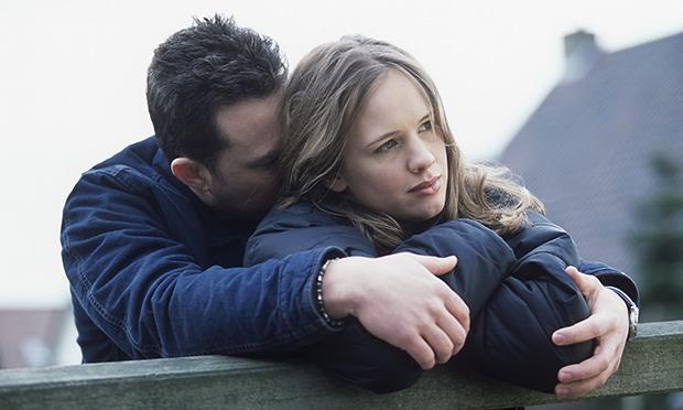 couple hugging sad