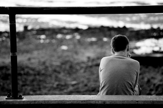 boy sitting on steps after byu denied application