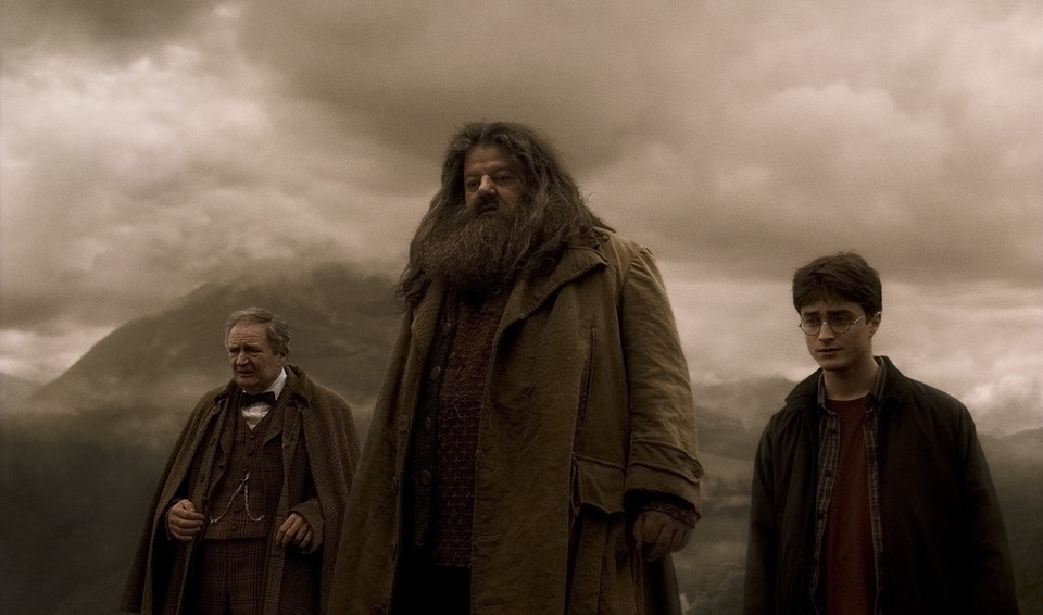 Slughorn with Harry and Hagrid on overcast day