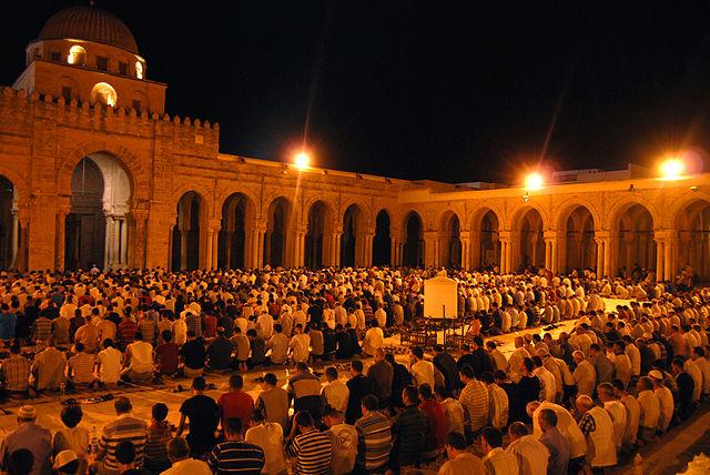 Muslims praying at mosque during month of Ramadan