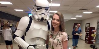 Marian Spencer poses with a stormtrooper in the Church Office Building cafeteria on Star Wars Day.