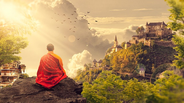 Monk on hill practicing Meditation castle in background