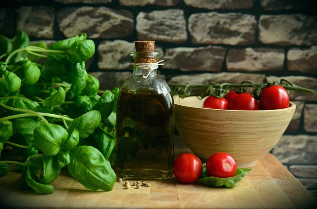 Basil, Olive Oil, Tomatos on a table