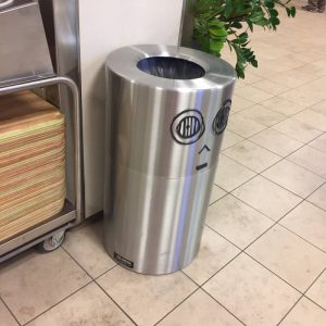 A trash can decorated to look like C3PO.