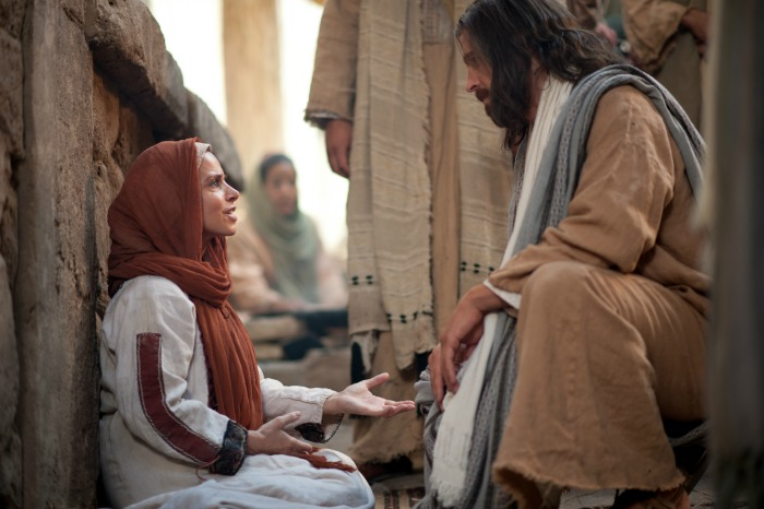 Jesus heals the woman with an issue of blood.