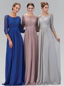 Three women model modest prom dresses.