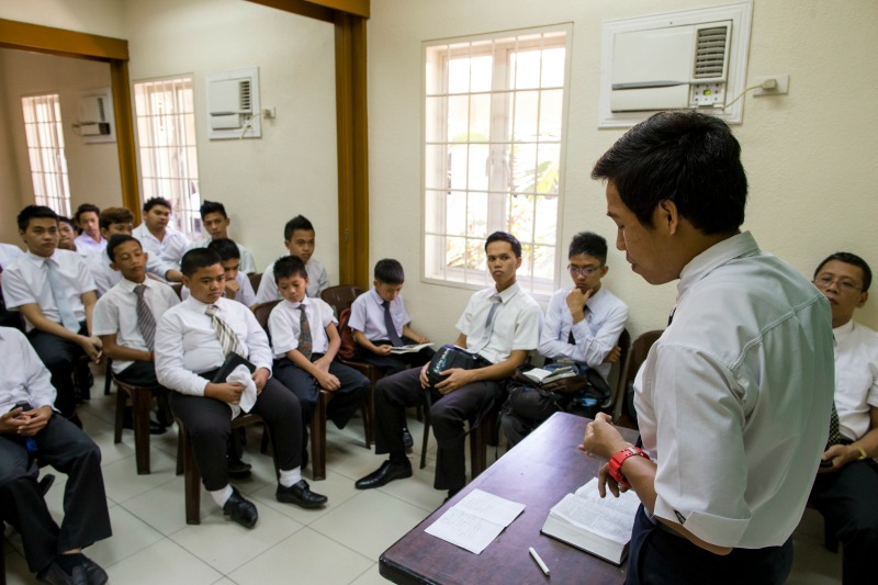 A young man teaches Sunday School.