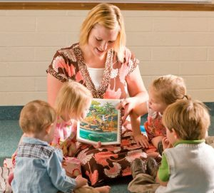 A female primary teacher teaches a sunbeam class.