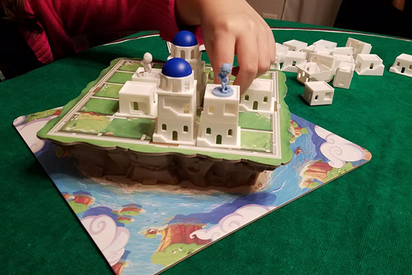 Playing the family board game Santorini