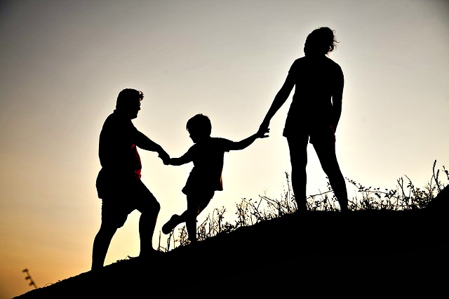 Family with a Kid at sunrise