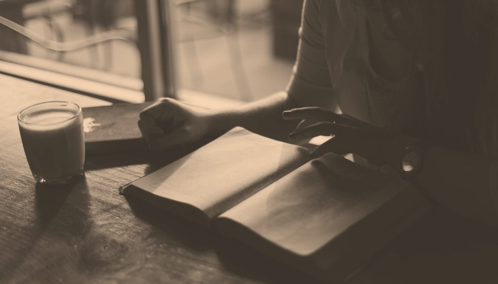 A person getting ready to write in a journal