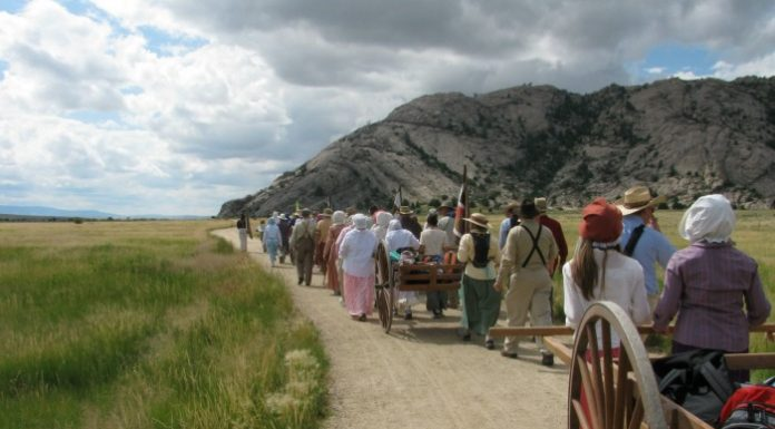 Mormon youth participate in a pioneer trek re-enactment.
