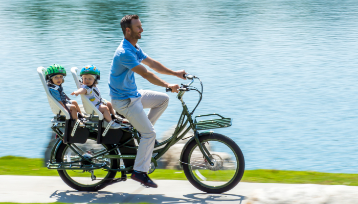 Dad on bike with kids