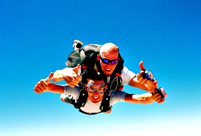 Two Men Smiling while skydiving