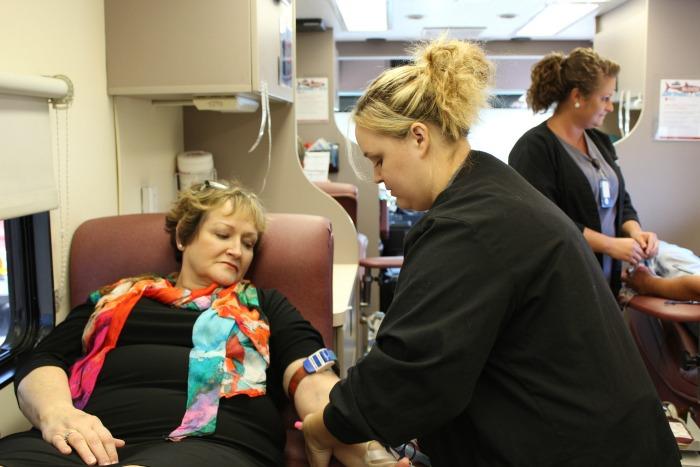 A woman donates blood