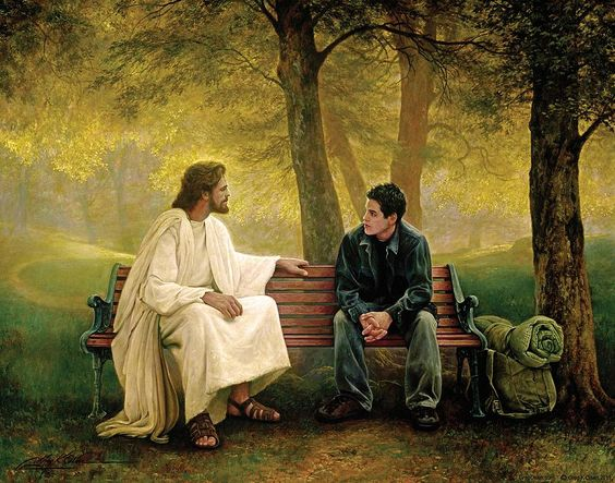 Christ talking with young man on park bench.