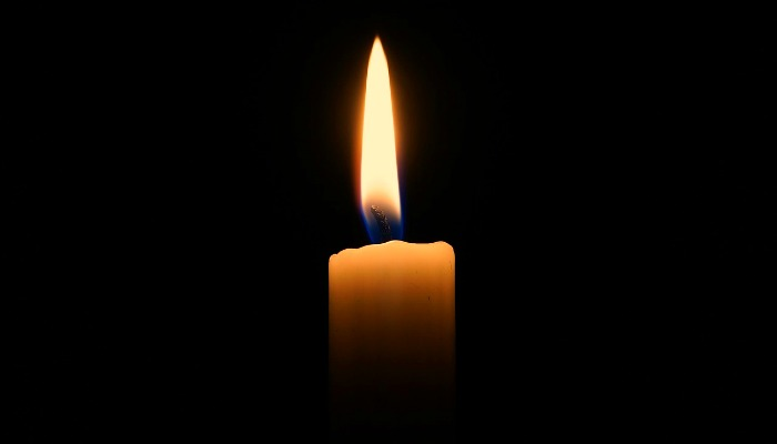 a candle with black background