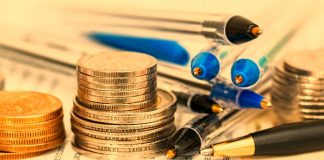Coins, pens and documents