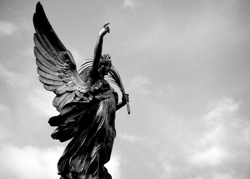 Angel Statue Pointing Upward