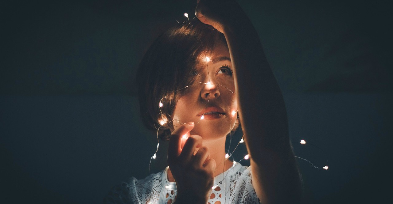 Girl with fairy lights around head