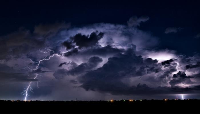 moon behind dark clouds