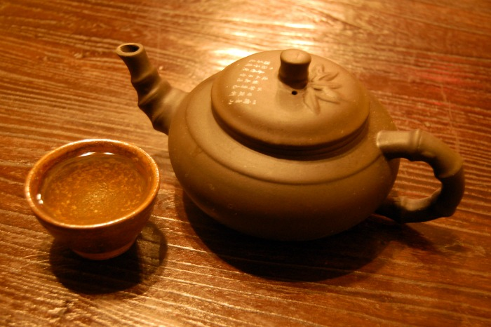 Oriental Tea Pot On Wood