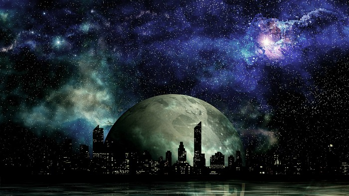 A Science Fiction Cityscape silhouetted against a moon