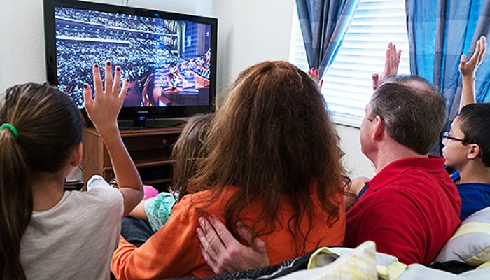 Family watching General Conference at home