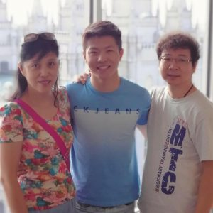 A photo of ChenWei, center, and his parents, mom left, dad right, in front of the Salt Lake City LDS Temple