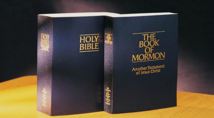 Holy Bible and Book of Mormon standing together on a table