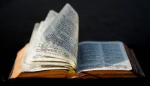 A Bible with pages fluttering