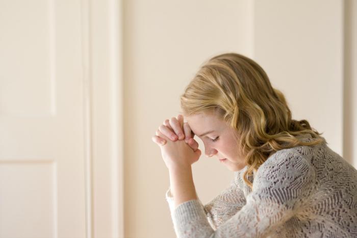 young woman praying mean girls bullying church