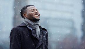 man enjoying falling snow