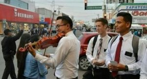 LDS Missionaries playing violin in Mexico