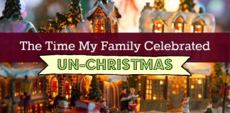 """Photo of a lit up, miniature Christmas town with the title, """"The Time My Family Celebrated Un-Christmas"""""""