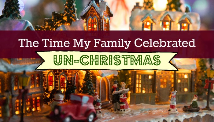Photo of a lit up, miniature Christmas town with the title,