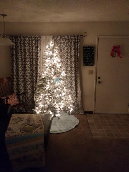 Lit fake Christmas tree