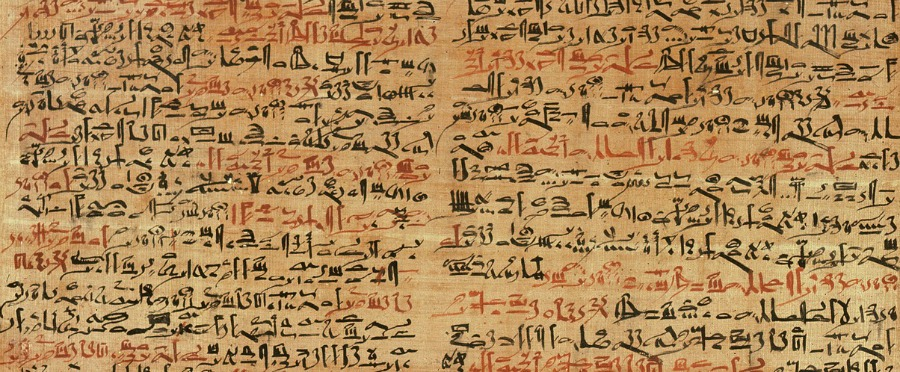 Ancient scroll with foreign language written on it.
