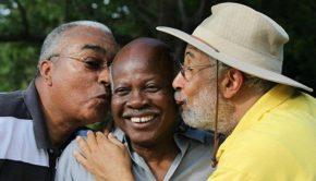 Image of three men having fun outside