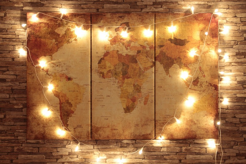 Map of the world with lights hanging around it