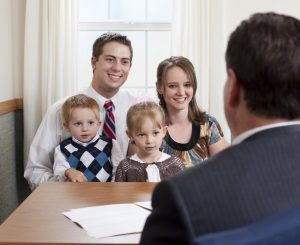 A bishop interviewing a family.